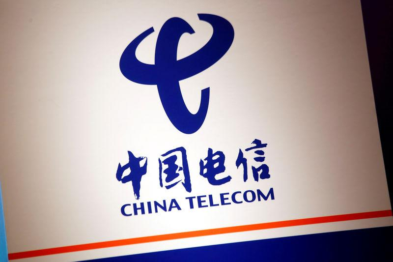 FILE PHOTO: The company logo of China Telecom is displayed at a news conference in Hong Kong