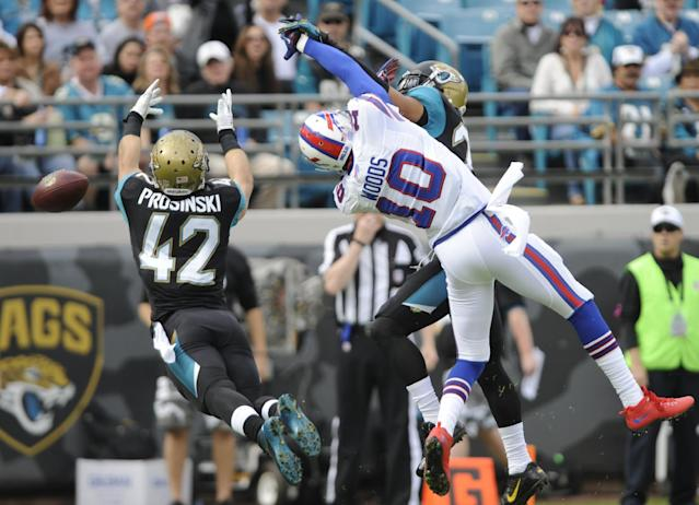 Jacksonville Jaguars free safety Chris Prosinski (42) goes for the ball after a pass intended for Buffalo Bills wide receiver Robert Woods (10) was broken up by Jacksonville Jaguars cornerback Dwayne Gratz, during the first half of an NFL football game in Jacksonville, Fla., Sunday, Dec. 15, 2013. (AP Photo/John Raoux)