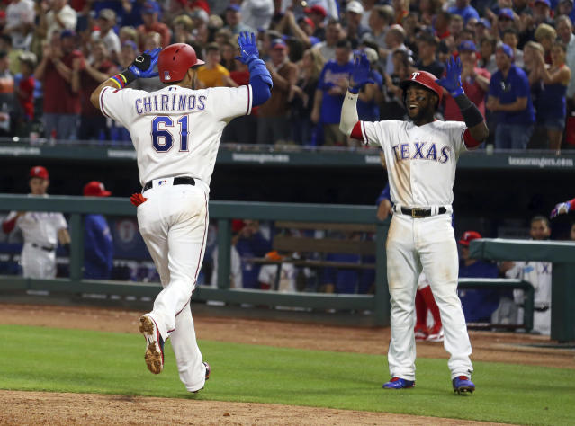 Texas Rangers Robinson Chirinos (61) is greeted by Jurickson Profar (19) after a two-run home run to tie the baseball game against the Oakland Athletics Monday, April 23, 2018, in Arlington, Texas. (AP Photo/Richard W. Rodriguez)