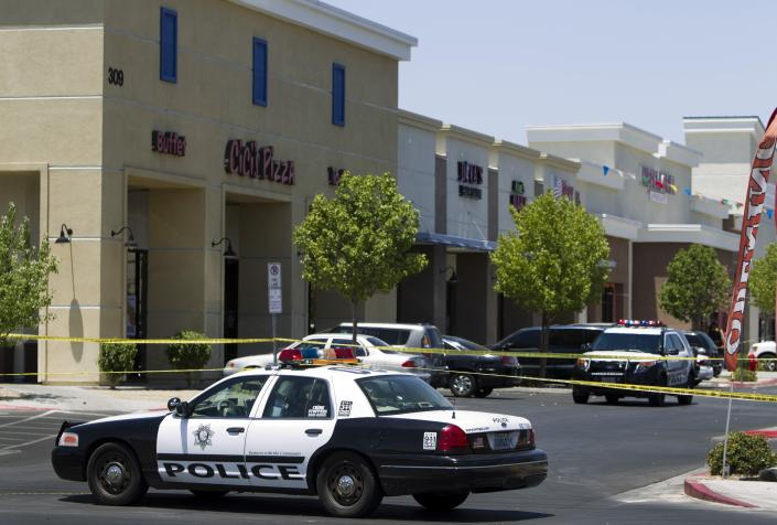 """Metro Police patrol cars are used to block off access to CiCi's Pizza after a shooting in Las Vegas June 8, 2014. Two armed suspects shouting """"this is a revolution"""" opened fire and wounded two Las Vegas Metropolitan police officers eating lunch in the pizza parlour on Sunday, then shot and killed a civilian inside a nearby Wal-Mart store before killing themselves, police said. REUTERS/Las Vegas Sun/Steve Marcus (UNITED STATES - Tags: CRIME LAW TPX IMAGES OF THE DAY)"""