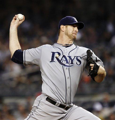 Tampa Bay Rays starting pitcher Jeff Niemann winds up in the second inning against the New York Yankees during their baseball game at Yankee Stadium in New York, Wednesday, May 9, 2012. (AP Photo/Kathy Willens)
