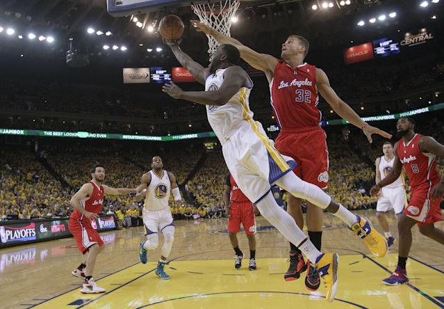Golden State Warriors small forward Draymond Green, front left, shoots against Los Angeles Clippers forward Blake Griffin (32) during the first half of Game 6 of an opening-round NBA basketball playoff series in Oakland, Calif., Thursday, May 1, 2014. (AP Photo/Marcio Jose Sanchez)
