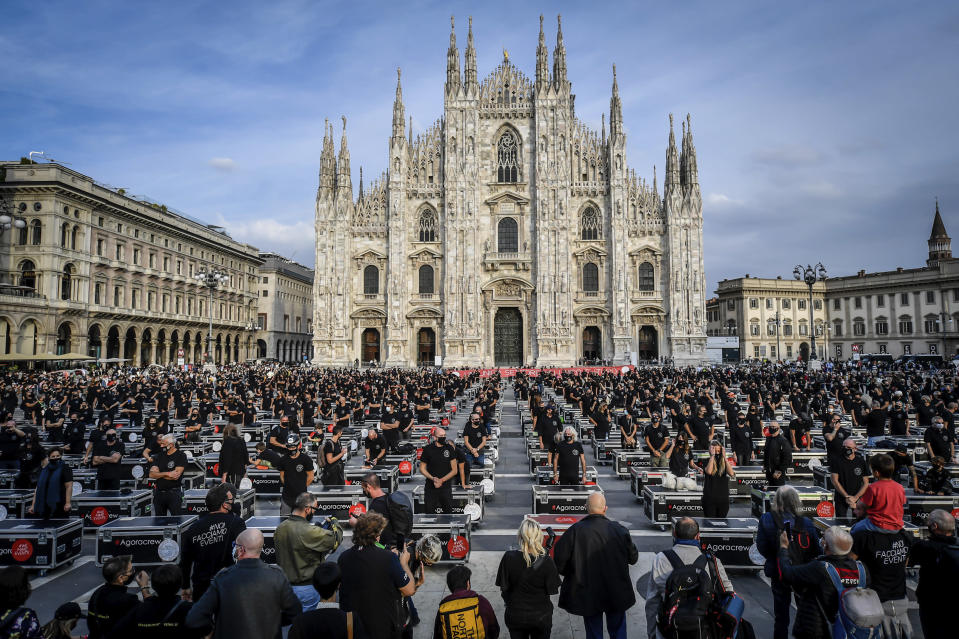Entertainment workers protest against the Italian government's economic policies to combat the spread of COVID-19, in front of Milan's Duomo Cathedral, Italy, Saturday, Oct 10, 2020. (Claudio Furlan/Lapresse via AP)