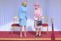 <p>The Queen wore a pink floral print dress by Stewart Parvin and a matching hat by Rachel Trevor-Morgan for the historic meeting.</p>