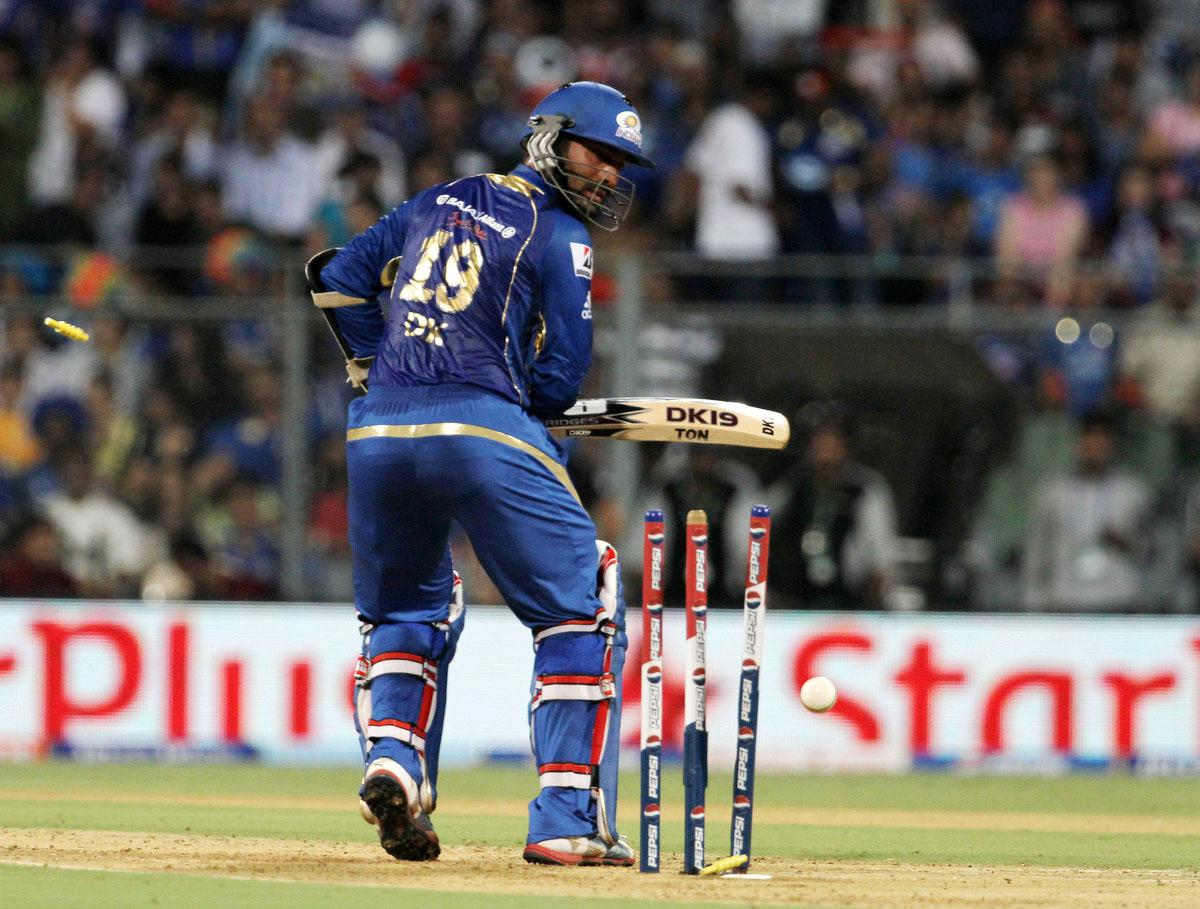 Mumbai Indian player Dinesh Karthik get bowled during match 41 of the Pepsi Indian Premier League ( IPL) 2013 between The Mumbai Indians and the Kings XI Punjab held at the Wankhede Stadium in Mumbai on the 29th April 2013. (BCCI)