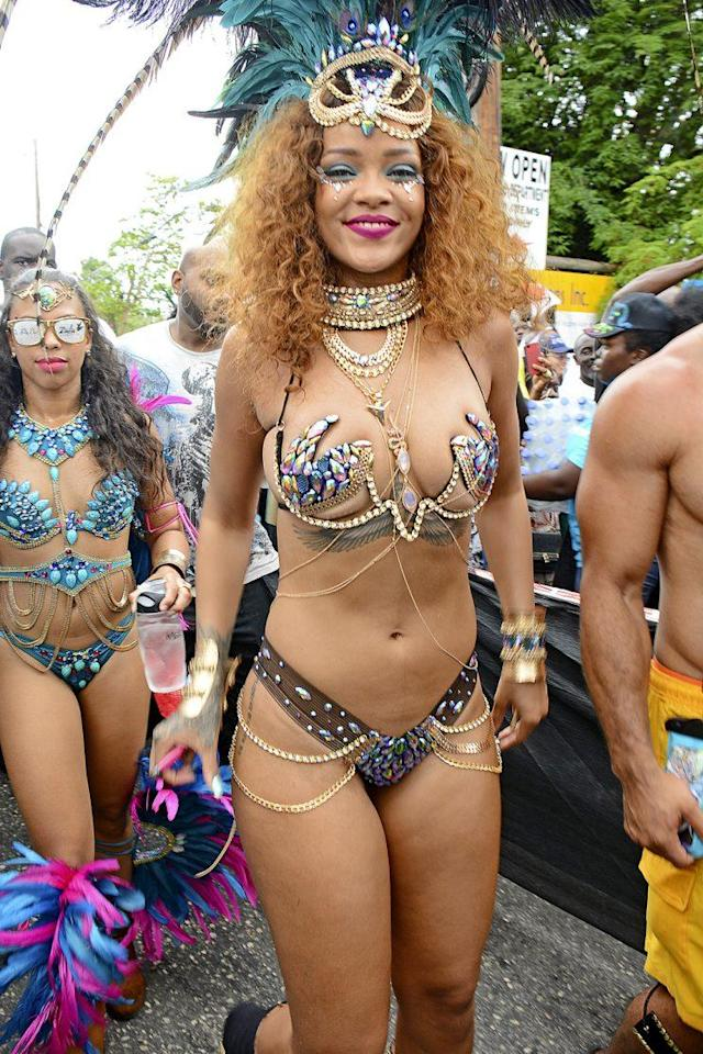 Rihanna proudly bared her bod at the Barbados Carnival in 2015. (Photo: Sandy Pitt/Splash News)