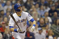 Milwaukee Brewers' Christian Yelich is watches his solo home run during the third inning of a baseball game against the Philadelphia Phillies, Friday, May 24, 2019, in Milwaukee. (AP Photo/Aaron Gash)