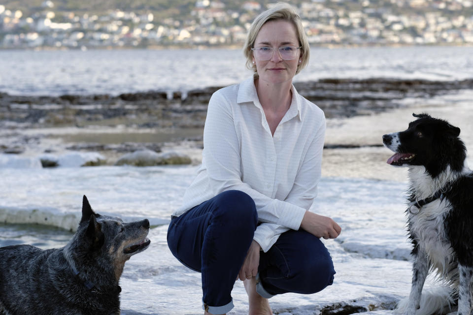 This photo shows pet custody specialist Karis Nafte with her dogs Sam, left, and Jax in Cape Town, South Africa, on June 12, 2021. Nafte helps couples settle disputes over their pets as more states move to make it easier for judges to consider the best interests of companion animals in divorce. (Eytan Nafte via AP).