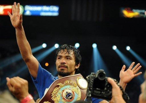 Manny Pacquiao of the Philippines celebrates after defeating US Shane Mosley during their bout for the World Boxing Organization welterweight title at the Garden Arena in the MGM Grand in Las Vegas, Nevada on May 7, 2011. Some boxing observers felt Floyd Mayweather might be treating Victor Ortiz as preparation for Pacquiao. But now it is anyone's guess