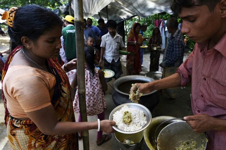In a small village in southern Bangladesh, hundreds of Hindu refugees from neighbouring Myanmar are being handed plates heaped with dal and rice, less than a mile from where desperate Rohingya beg for food and shelter