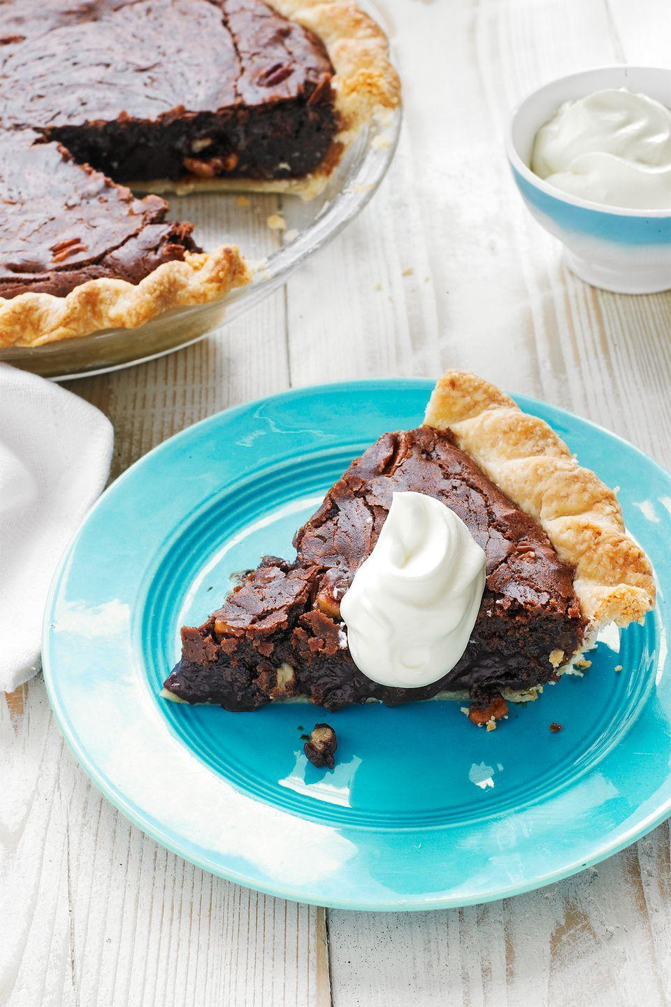 "<p>Named after North Carolina's dark and dense pine forests, this nutty, chocolate <a href=""https://www.countryliving.com/food-drinks/g1368/thanksgiving-pies/"" rel=""nofollow noopener"" target=""_blank"" data-ylk=""slk:Thanksgiving pie"" class=""link rapid-noclick-resp"">Thanksgiving pie</a> gets its flavor from pecans, chocolate chips, brown sugar, and coffee beans. </p><p><strong><a href=""https://www.countryliving.com/food-drinks/recipes/a31428/tar-heel-pie-recipe-wdy1112/"" rel=""nofollow noopener"" target=""_blank"" data-ylk=""slk:Get the recipe"" class=""link rapid-noclick-resp"">Get the recipe</a>.</strong></p><p><a class=""link rapid-noclick-resp"" href=""https://www.amazon.com/Camp-Chef-True-Seasoned-CIPIE10/dp/B000OXAQ6G?tag=syn-yahoo-20&ascsubtag=%5Bartid%7C10050.g.957%5Bsrc%7Cyahoo-us"" rel=""nofollow noopener"" target=""_blank"" data-ylk=""slk:SHOP PIE PANS"">SHOP PIE PANS</a> </p>"