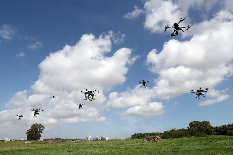 Delivery drones are seen midair during a demonstration whereby drones from various companies flew in a joint airspace and were managed by an autonomous control system in Haifa, near Hadera
