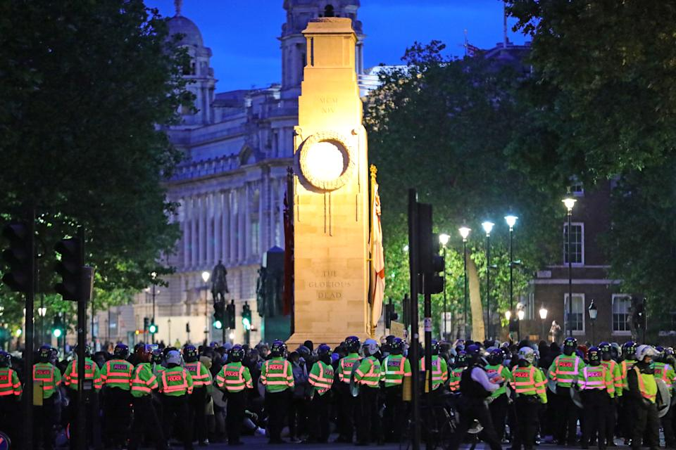 Police officers surround the cenotaph in Whitehall, London, during a Black Lives Matter protest rally. (PA)