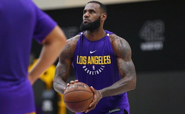 "The <a class=""link rapid-noclick-resp"" href=""/nba/teams/lal"" data-ylk=""slk:Los Angeles Lakers"">Los Angeles Lakers</a> posted pictures of <a class=""link rapid-noclick-resp"" href=""/nba/players/3704/"" data-ylk=""slk:LeBron James"">LeBron James</a> practicing in purple and gold to their Twitter account on Thursday."