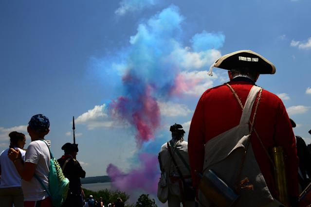 <p>David Embrey of Savage, MD watches fireworks as people gather to celebrate the Fourth of July at George Washington's Mount Vernon on Wednesday July 04, 2018 in Mount Vernon, Va. Embrey was portraying a Colonial Army fifer. (Photo: Matt McClain/The Washington Post via Getty Images) </p>
