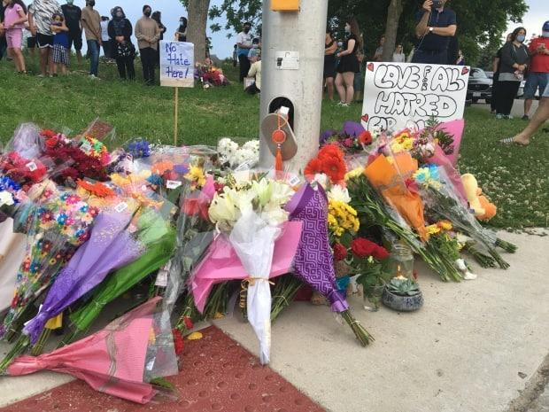 A memorial has grown in the hours since a Muslim family was killed on Sunday evening in London, Ont. Police believe their killing was motivated by anti-Muslim hate.