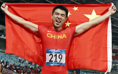 Athletics - 2018 Asian Games - Men's 110m Hurdles, Final - GBK Main Stadium, Jakarta, Indonesia - August 28, 2018 - Xie Wenjun of China celebrates his victory. REUTERS/Issei Kato