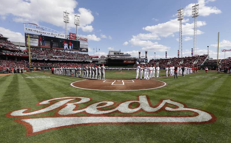 The Cincinnati Reds and Los Angeles Angels are introduced at the start of a major league baseball game, Monday, April 1, 2013, at Great American Ball Park in Cincinnati. (AP Photo/Al Behrman)