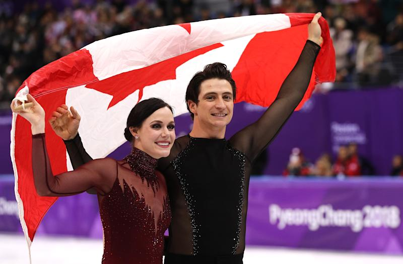 Virtue and Moir. Image via Getty Images.