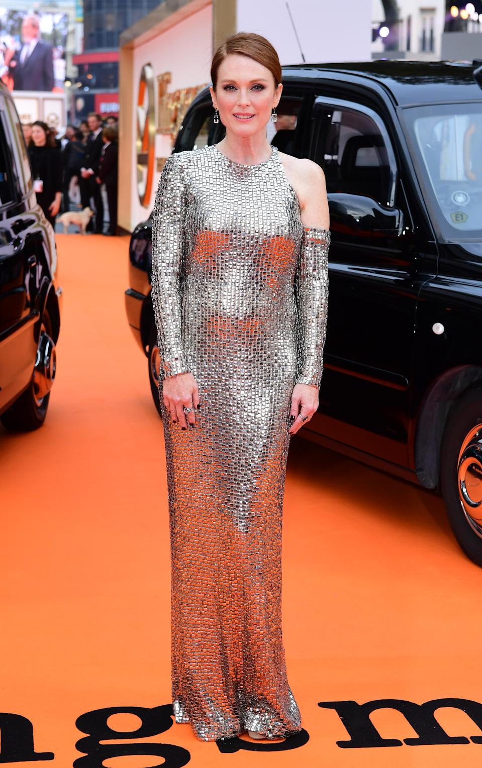 <p>56-year-old Julianne wowed in a metallic silver Tom Ford gown complete with a cold shoulder.<br><i>[Photo: PA]</i> </p>