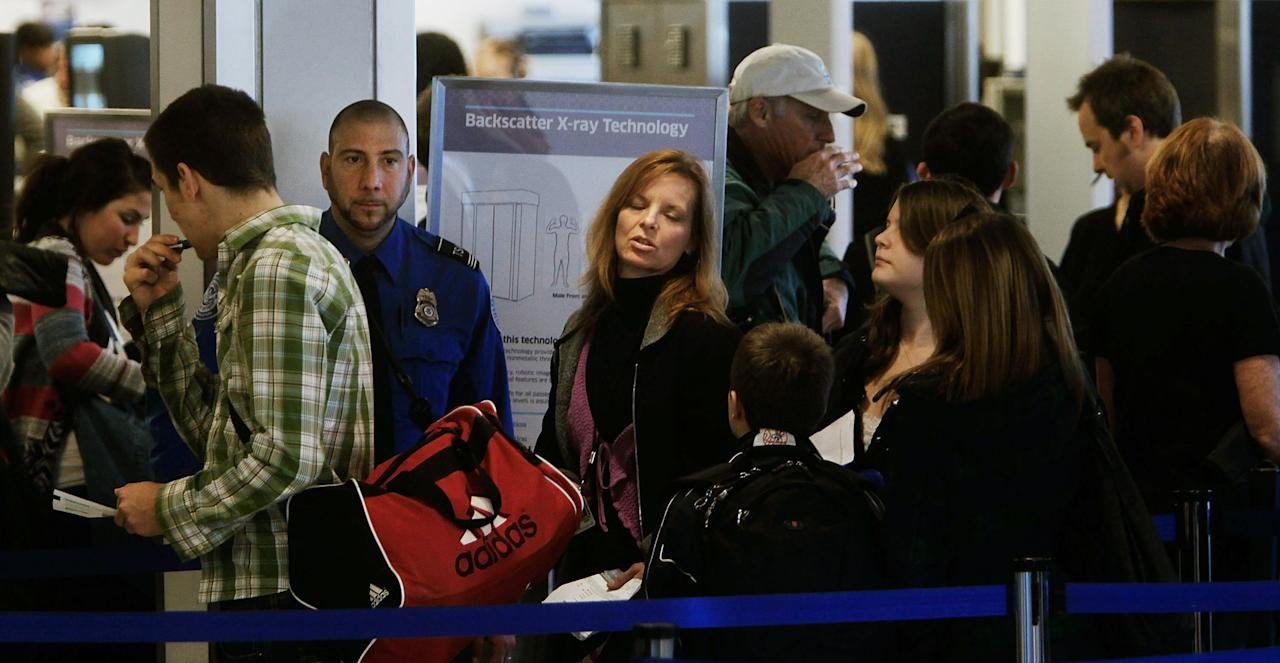NEW YORK - NOVEMBER 24:  Travelers stand in a airport security line November 24, 2010 at LaGuardia airport in the Queens Borough of New York City. Experts expect over 1.6 million people to fly over the Thanksgiving holiday this year, a 3.5% increase from last year. Airport officials are concerned that public protests against new security techniques such as National Opt-Out Day could further delay holiday travel.  (Photo by Chris Hondros/Getty Images)