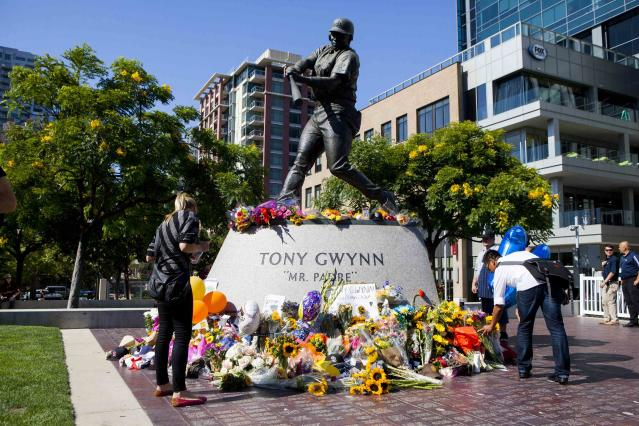 Fans leave flowers at a makeshift memorial to former San Diego Padres outfielder Tony Gwynn at Petco Park in San Diego, California June 16, 2014. Gwynn, one of the greatest hitters of his generation, died on Monday at age 54 after a battle with cancer, the National Baseball Hall of Fame and Museum said. REUTERS/Sam Hodgson (UNITED STATES - Tags: SPORT OBITUARY BASEBALL)