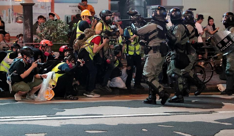 Anti-riot police aim at a group of media personnel in Mong Kok during a clearance operation last year. Photo: Edmond So