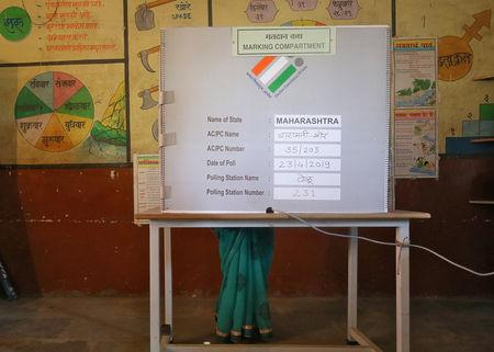 FILE PHOTO: A woman casts her vote at a polling station during the third phase of the general election on the outskirts of Pune, India, April 23, 2019. REUTERS/Francis Mascarenhas/File Photo