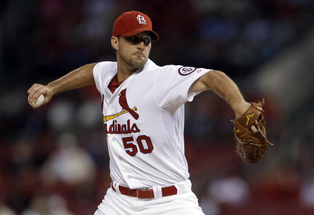 St. Louis Cardinals starting pitcher Adam Wainwright throws during the first inning of a baseball game against the Seattle Mariners on Friday, Sept. 13, 2013, in St. Louis. (AP Photo/Jeff Roberson)