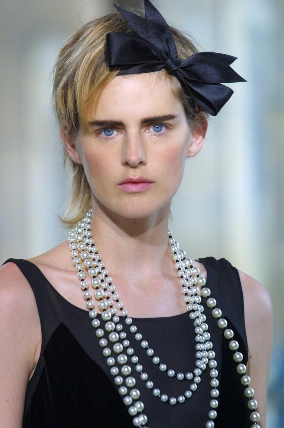 Pretty in pearls: Tennant models for Chanel in 2001/2Miquel Benitez/REX