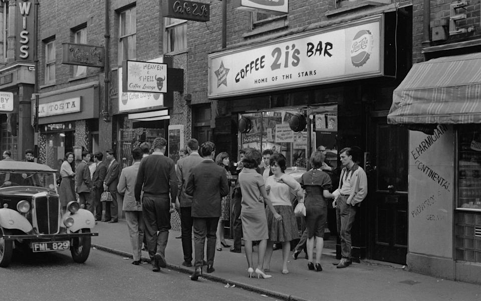 A group of young people outside the 2 I's coffee bar in Soho, London, April 1961. (Photo by Archive Photos/Getty Images)  - Getty