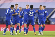 Leicester's Wilfred Ndidi, center, celebrates with teammates after scoring his team's opening goal during the English Premier League soccer match between Leicester City and Chelsea at the King Power Stadium in Leicester, England, Tuesday, Jan. 19, 2021. (Michael Regan/Pool via AP)