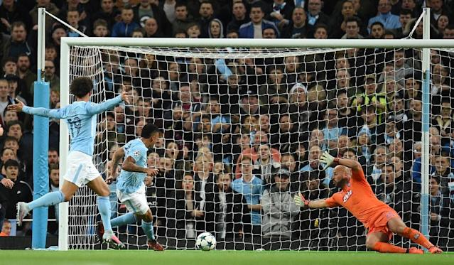 Manchester City's striker Gabriel Jesus (2ndL) scores his team's second goal against Napoli on October 17, 2017 (AFP Photo/Oli SCARFF )