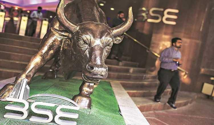 Sensex falls over 325 pts on weak global cues
