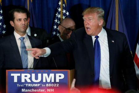 FILE PHOTO: Donald Trump Jr. (L) watches his father Republican U.S. presidential candidate Donald Trump (R) gesture to the crowd as he leaves the stage on the night of the New Hampshire primary in Manchester, New Hampshire, U.S. February 9, 2016.   REUTERS/Jim Bourg/File Photo