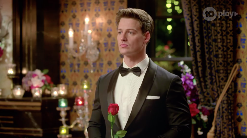Bachelor Matt Agnew holds a rose at the rose ceremony