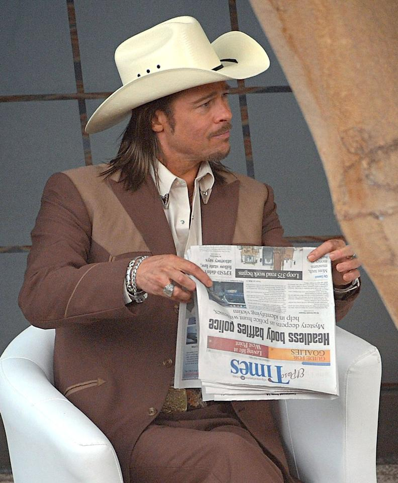"""<b>Brad Pitt Cowboys Up</b><br><br>This is our first look at Brad Pitt in character on the set of """"The Counselor"""" -- seen on Monday, July 30. <br><br>In the thriller, Pitt plays a mysterious figure in the drug trade named Westray. He advises leading man Michael Fassbender, who plays a lawyer in over his head.<br><br>The Ridley Scott film is shooting in London, which likely suits Pitt just fine since his main squeeze Angelina Jolie and the rest of their family have been residing in England <a href=""""http://tv.yahoo.com/blogs/movie-talk/angelina-jolie-maleficent-first-photo-165911375.html"""">while she films """"Maleficent.""""</a><br><br>""""The Counselor"""" cast also includes Javier Bardem, Cameron Diaz and Penelope Cruz."""