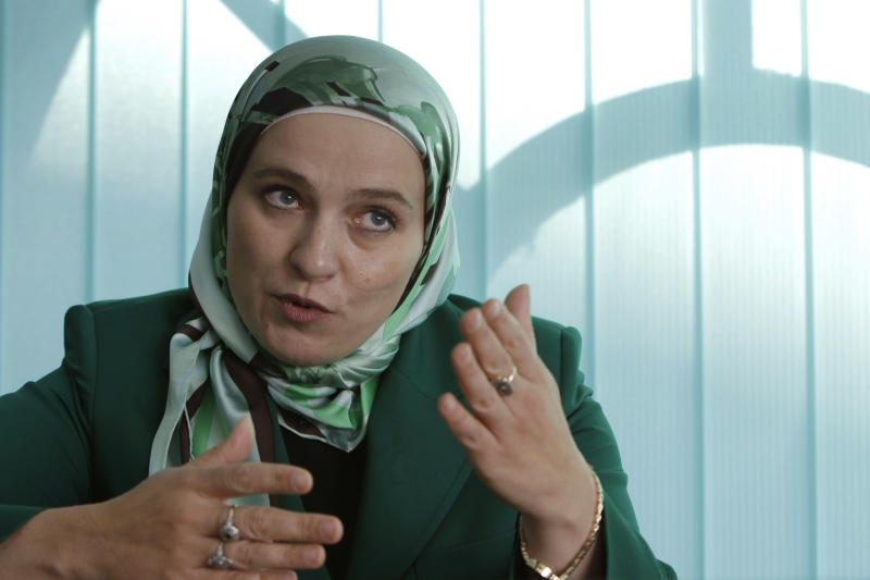 This Oct. 16, 2012 photo shows Amra Babic, mayor of the Bosnian town of Visoko, answering a journalist question during an interview, in Visoko, 30 km north of Sarajevo, Bosnia. The 43 year-old economist has blazed a trail in this war-scarred Balkan nation by becoming its first hijab-wearing mayor, and possibly the only one in Europe. Her victory comes as governments elsewhere in Europe debate laws to ban the Muslim veil, and Turkey, another predominantly Islamic country seeking EU membership, maintains a strict policy of keeping religious symbols out of public life. For Babic, the electoral triumph is proof that observance of Muslim tradition is compatible with Western democratic values. (AP Photo/Amel Emric)