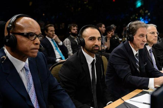 Paul Malignaggi (second from left) is one of boxing's best TV analysts. He's working a fight here with (from left) Virgil Hunter, Kevin Harlan and Steve Farhood. (Getty Images)