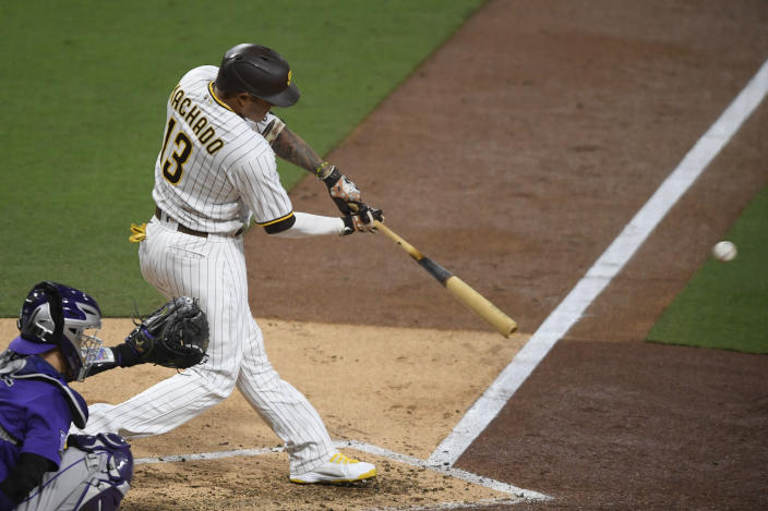 San Diego Padres' Manny Machado (13) hits a double during the fifth inning of a baseball game against the Colorado Rockies, Monday, May 17, 2021, in San Diego. (AP Photo/Denis Poroy)