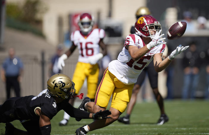 Southern California wide receiver Drake London, right, pulls in a pass as Colorado cornerback Christian Gonzalez defends in the first half of an NCAA college football game Saturday, Oct. 2, 2021, in Boulder, Colo. (AP Photo/David Zalubowski)