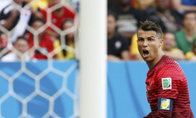 Portugal's Cristiano Ronaldo reacts after missing a goal scoring opportunity against Ghana during their 2014 World Cup Group G soccer match at the Brasilia national stadium in Brasilia June 26, 2014. REUTERS/Jorge Silva (BRAZIL - Tags: SOCCER SPORT WORLD CUP)