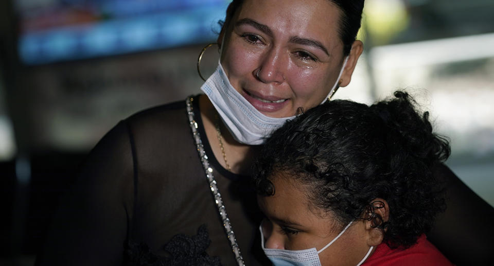 Glenda Valdez was shocked to spot her daughter standing barefoot on the US-Mexico border in TV footage. Source: AP