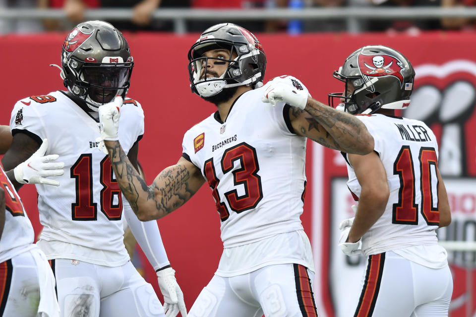 Tampa Bay Buccaneers wide receiver Mike Evans (13) celebrates his touchdown against the Atlanta Falcons during the first half of an NFL football game Sunday, Sept. 19, 2021, in Tampa, Fla. (AP Photo/Jason Behnken)