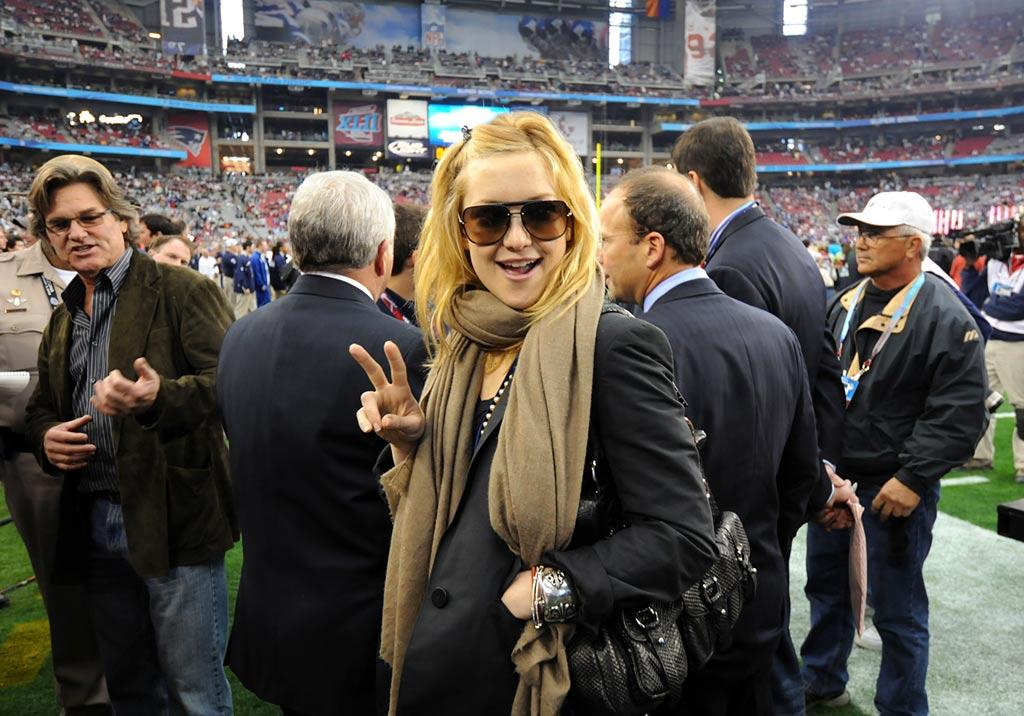 "Celebrities receive many perks, including tickets to Super Bowl XLII! Kate Hudson and her ""dad"" Kurt Russell make the most of their all-access passes by hanging out on the field during the pre-game festivities. Jeff Kravitz/<a href=""http://filmmagic.com/"" target=""new"">FilmMagic.com</a> - February 3, 2008"