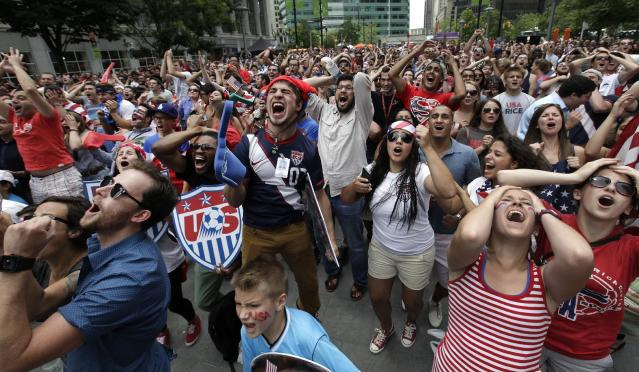 United States fans react while watching the final minutes of the 2014 World Cup soccer match between the United States and Germany at a public viewing party, in Detroit, Thursday, June 26, 2014. Germany defeated the United States 1-0 to win Group G ahead of the Americans, who also advanced to the knockout stage of the World Cup despite losing. (AP Photo/Paul Sancya)