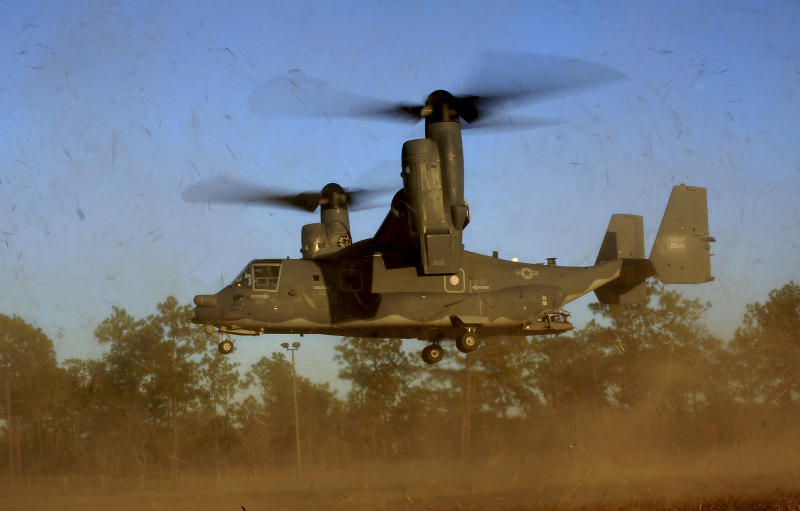 "In this photo taken Jan. 26, 2011 and released by the U.S. Air Force, a CV-22 Osprey aircraft of the 8th Special Operations Squadron (SOS) ""Black Birds"" comes in for a landing during a local training mission at Hurlburt Field, Florida, USA. Gunfire hit three U.S. military CV-22 Osprey aircraft Saturday, Dec. 21, 2013 trying to evacuate American citizens in Bor, the capital of the remote region of Jonglei state in South Sudan, that on Saturday became a battle ground between South Sudan's military and renegade troops, officials said, with four U.S. service members wounded in the attack. (AP Photo/US Air Force, Master Sgt. Jeremy T. Lock)"