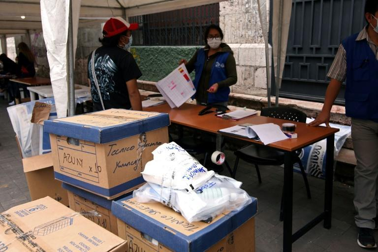 Ecuadorian electoral workers organize the materials for the upcoming general elections at the National Electoral Council of Azuay, in Cuenca, Ecuador