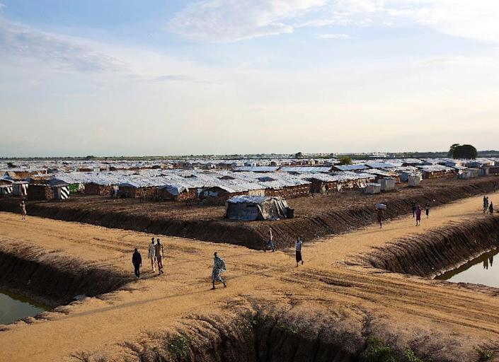 There are around 120,000 people living in South Sudan's Bentiu camp and many fear that if they leave, their ethnicity would make them a target for government soldiers (AFP Photo/TRISTAN MCCONNELL)