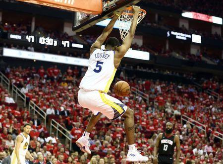 May 24, 2018; Houston, TX, USA; Golden State Warriors forward Kevon Looney (5) dunks the ball during the third quarter in game five of the Western conference finals of the 2018 NBA Playoffs against the Houston Rockets at Toyota Center. Mandatory Credit: Troy Taormina-USA TODAY Sports